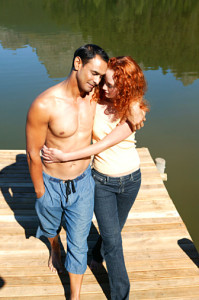 Couple embracing on dock